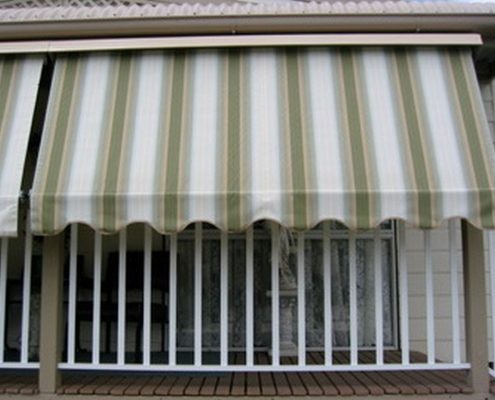 Auto lock green, white and yellow stripe arm awnings