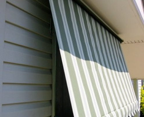 Auto lock green and white arm awnings