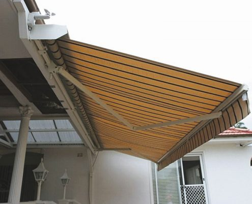 Yellow and black folding arm awnings | Ublinds