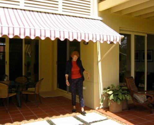 Stripes pivot arm awnings | Ublinds