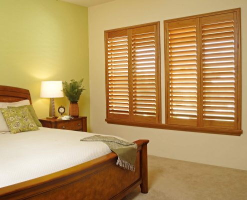 Timber shutters in a master bedroom.