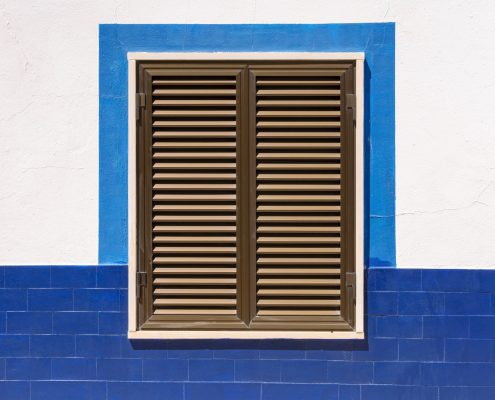 Different Types of Shutters - Blog Featured Image Showcasing a Mediterranean Style Shutter